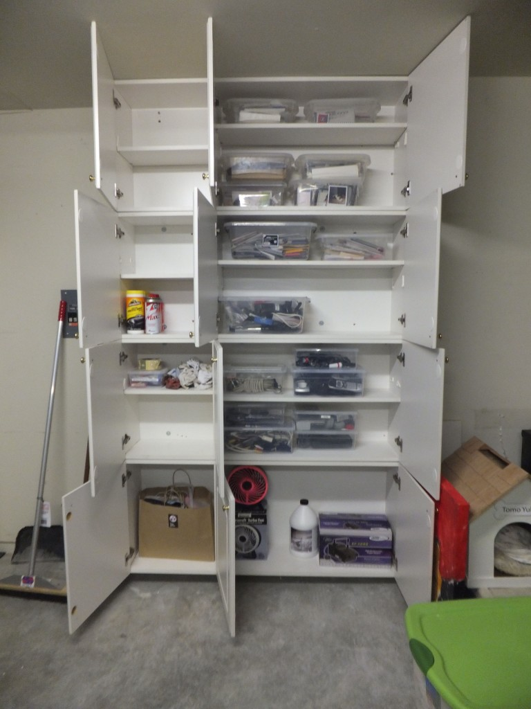 We utilized the new white cabinets for cleaning supplies, tools and ...